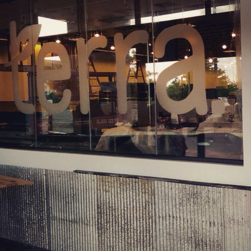 terra logo on glass